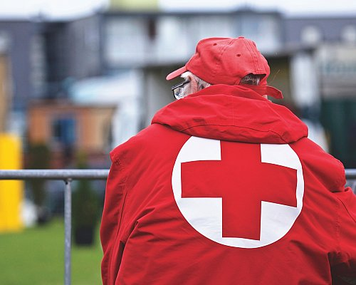 Man In Red Cross Jacket
